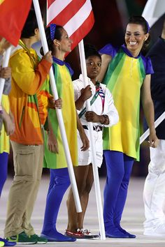 Flag bearer Simone Biles of United States participates during the 'Heroes of the…