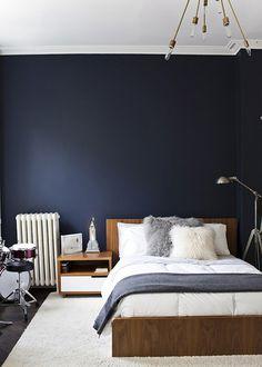 Dark walls, fab brass light. Preciously me blog Michelle James' home in Brooklyn