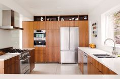 modern renovation aqua lair kitchen walnut cabinetry
