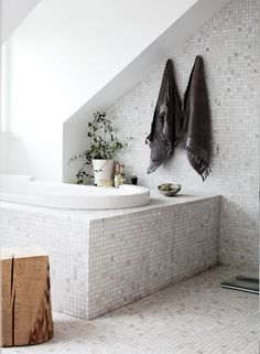 Amazing Casual Nordic Interior In Black, White And Grey : Casual Nordic Interior In Black, White And Grey With Bathroom Wall Bathtub Window Towel Chair Ceramic Floor Candle Plant Decor Mosaic Bathroom, Attic Bathroom, Small Bathroom, Mosaic Tiles, Marble Mosaic, Bathroom Ideas, Wood Tiles, Tub Tile, Neutral Bathroom