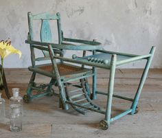 Convertible highchair. I have been looking for this. Mine was so similar & I swear I remember sitting in it & playing!
