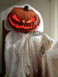 pumpkin-headed ghost with skelly hands