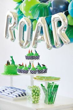 Your little T-Rex is going to go wild for our new prehistoric Dinosaur Roar birthday adventure! Everything from the jungle balloon garland and dinosaur cookies. Dinosaur birthday party ideas.
