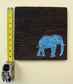Do the elephant in burgundy for Avery's room on a houndstooth background.