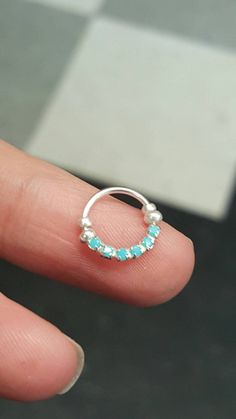 """Sterling Silver Turquoise Crystal Septum Cartilage Jewelry Captive Hoop 5/16"""" 18g Daith Rook Piercing Earring Ring Nose Lip Eyebrow Tragus by ABodyJewelry on Etsy https://www.etsy.com/listing/250455762/sterling-silver-turquoise-crystal-septum"""