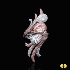 A most beautiful fancy pink pear is the centerpiece of this beautiful ring…