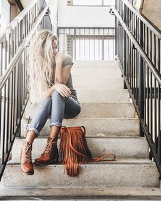 @tifforelie in the Sabrina 6G boots and Ray Fringe Crossbody   The Frye Company