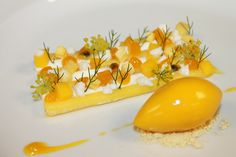 """""""Pina Colada"""" Pineapple Curd, Coconut Mousse, Mango Crocante, Coconut Rock, Mango Fluid Gel, Tropical Fruits, Passion Fruit Sorbet, Micro Fennel Flowers 