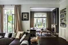 brown beige and silver elegant living room Modern French Interiors, French Interior Design, Elegant Living Room, My Living Room, Mood Words, Murs Beiges, Mirrored Side Tables, Beige Walls, Fine Furniture