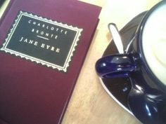 Image shows a copy of Jane Eyre next to a cup of tea.