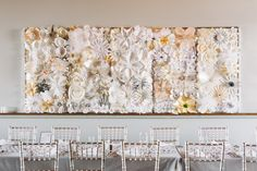 Pretty amazing DIY paper flower panel -- on http://www.StyleMePretty.com/midwest-weddings/2014/04/01/a-modern-affair-at-chicagos-bottom-lounge/ TandSHughesPhotography.com