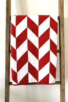 Craftyblossom: red and white herringbone quilt. I've pinned several of her quilts not realizing it was all her. for my yellow quilt maybe