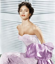 "... Dorothy Dandridge! Halle Berry, who played Dorothy in the TV movie ""Introducing Dorothy Dandridge,"" looks just like the groundbreaking actress. Some of Dorothy's dresses, which were used for the film, even fit Halle like a glove."