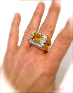 Gorgeous Piece Features a Brilliant Emerald Cut Center Stone That Sparkles and Flashes with A Dramatic Hall Of Mirrors Effect Framed By A Shimmering Pave Border The Glowy Luminous Setting Tapers Into a Solid Silver Band Beneath The Finger. Absolutely Breathtaking  Would Pair Nicely