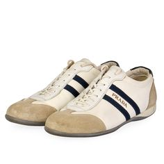 These Prada Sneakers promise to afford their wearer a lifetime of comfort and impeccable style.  ITEM CONDITION: Pre-owned – Very good condition.  SUPPLIED WITH: These shoes are supplied with a Luxity dust bag.  SIZE: 37 (UK size 4)  THE LEFT SHOE: Very good condition – With normal signs of wear.  THE RIGHT SHOE: Very good condition – With normal signs of wear. Prada Sneakers, Prada Shoes, Suede Sneakers, Adidas Sneakers, White Beige, Dust Bag, Signs, Style, Fashion