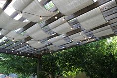 pergola canopy made from canvas drop clothes - from http://www.anythingpretty.com/2010/07/buying-fabric-at-hardware-store.html