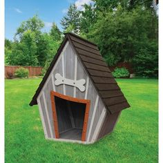 "Features: -Solid wood construction. -Peak roof. -Will accommodate a Golden Retriever. Finish: -Gray/White. Material: -Wood. Dimensions: Overall Height - Top to Bottom: -43"". Overall Width - Sid"