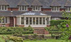 A large property with a traditional conservatory incorporates a breakfront design and bi-folding doors.