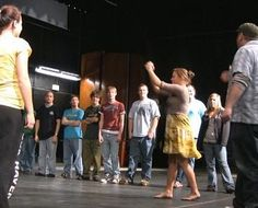 WARNING: We simply must Warm-Up http://newyorkimprovtheater.com/2014/12/01/lets-warm-up/ Singers prepare their voices. Dancers stretch their limbs. Improvisers need to warm-up their minds, bodies and the team. Professional talent uses the following exercises regularly before rehearsals...