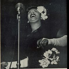 """This photo of Billie is taken from Metronome magazine's issue in 1948 """"Billie Holiday,looking as beautiful and sounding as wonderful as ever,returned to the jazz world on March 27th at a concert in New York's Carnegie Hall. To the enthusiastic ovation of an audience that overflowed onto Carnegie's huge stage. Lady came back in a blaze of glory,singing all her familiar songs in the highly stylized Holiday fashion,to the accompaniment of a rhythm section.Billie has long been one of America's…"""