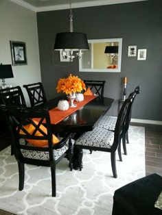 warm transitional dining room, red wall is behr cherry cobbler