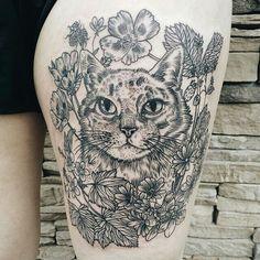 Detailed cat flower botanical tattoo by Pony Reinhardt: