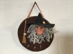 This plaque key hanger was made from a new mdf plaque and decorated with a polymer clay witch, leather hat and her broom. I have used felt for the background and ribbon detail around the sides. Leather Hats, Kitchen Witch, Captain Hat, My Etsy Shop, Crochet Hats, Felt, Detail, Handmade, Products