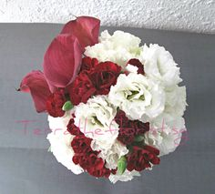 Styled with lisianthus, calla lilies  and carnations.