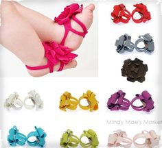 Baby Barefoot Sandals- okay, I hate to see bows on baby heads because I think they look ridiculously uncomfortable (prob because I think head bands are uncomfortable on me) but these are just so cute I might have to be okay with strapping flowers to baby feet...