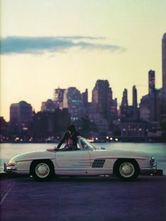 """""""Status and Speed"""", photographed for Playboy by Jerry Erlich, featuring a Mercedes-Benz 190SL Cabrio convertible (June 1960)"""