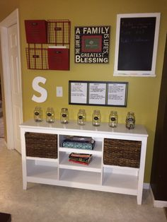 Love my new Command center! The jars are their chore money.  They get a roll of dimes in it at the beginning of the week. After they pay taxes & tithes they have $4 left to work with.  Their chart is the way they carry weight in this family.  Take out the trash, unload the dishwasher etc, there\'s also a chart where they carry \