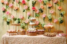 An easy DIY flower wall to showcase the dessert buffet! Indian wedding - Indian wedding decor - wedding decor ideas - floral wedding decor #thecrimsonbride