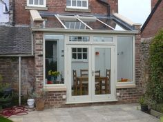 Basic lean-to design, hardwood conservatory. Derbyshire Colour Brick Cosmetics say - This property's extension has been brick matched and can be challenging. We can take that challenge away Garden Room, Updating House, House Styles, House Design, Glass House, New Homes, Cottage Extension, Small Conservatory, Cottage