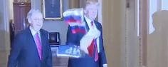 WATCH: As President Walks Through Congress Protestor Yells 'Trump Is Treason' While Throwing Russian Flags