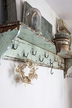 Shabby Shelf / With nine hooks to hold so many things.