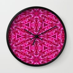 A beautiful hot pink cabbage rose photo transformed in a abstract wall clock.