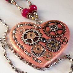 Steampunk Sunset Orange Polymer Clay Heart Beaded Necklace with Metal Gears and Dyed Jade beads from Rogue Bea Studio.