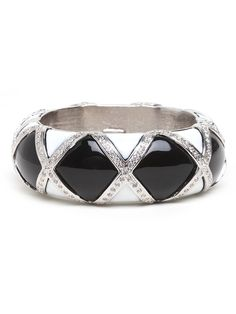This cuff is bold and oh-so-beautiful. It rocks a supremely ladified vibe while working a cool harlequin pattern, too. The major highlight here: the criss-cross motif made from Swarovski crystals.