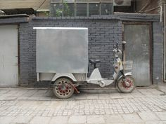 """""""The rickshaw, a two-wheeled human drawn passenger cart, appeared in China in the mid to late 1800s.  Their popularity began to decline in the 1920s and by 1950 and the founding of the PRC most manual rickshaws were gone, perhaps in part because they had become a symbol of oppression of the working class. But the two and three-wheeled cycle and other animal and motor drawn vehicles are still in use today."""""""