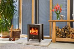 The 525 multi-fuel stove is part of ESSE's contemporary range and looks equally good in a fireplace or free standing. Available with matt black or stainless steel legs, this stove has a 5 kW output. A flue-less gas version of the 525 is also available.