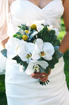 This one is awfully pretty. I know this one has a lot of white, but I'm branching out lol. The really dark green in the back drop is what made me pin it. A lot of other succulent bouquets seem to have that almost dusty looking green and I'm certain there has to be more samples with bolder emeralds. You don't even have to live nearby to expose me to new things it seems lol.