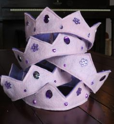 easy diy princess crowns -- sew coordinating colours of felt together, hot glue dollar store jewels on.