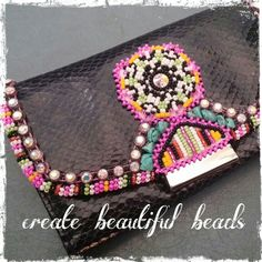 Beaded wallet made by create beautiful beads on facebook! $50
