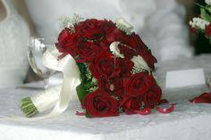 Red roses on white linen.