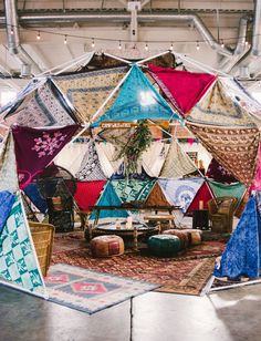 Ultimate boho mandala fort featuring Moroccan poufs and peacock chairs // 1969 Camp Wild n Free Event