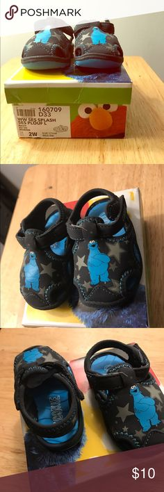 Sesame Street (boy) infant sandals Sesame Street (Cookie monster) boys sandal. Size 2W. Gently used but in very good condition. Fits comfortably and easy to put on velcro straps. Sesame Street Shoes Sandals & Flip Flops