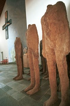 """Magdalena Abakanowicz once described her sculpture as """"a search for organic mysteries."""" Headless figures made of brown sackcloth in the Church of St. Anna in Hellenthal, Germany, in 1999."""