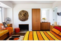 """We give the master suite to friends and family so that they can enjoy the great view… and the lion,"" says Trina. (It's one of three macramé animal heads by artist Judee du Bourdieu.) ""We're kind of obsessed.""  Find More Creative High End Designer  Home Decor Accessories Visit us online! http://www.ancienteyebohemianarts.com/"