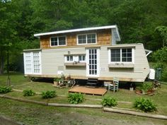 It was converted into a beautiful tiny house on wheels with a functioning slide-out for extra space.