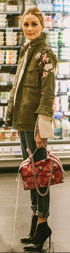 Who made Olivia Palermo's black ankle boots, pink print handbag, and green floral jacket?